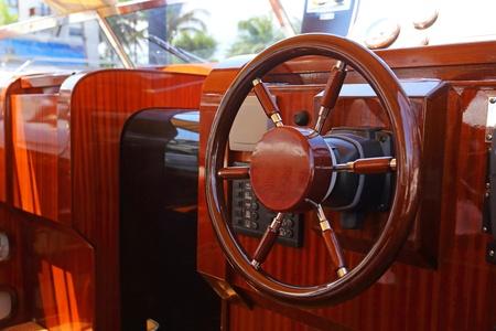 steering wheel on a luxury yacht cabin  photo