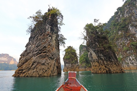 Three rocks in Cheow Lan Lake, Ratchaprapa Dam, Khao Sok National Park, Thailand  Stock Photo - 18974994
