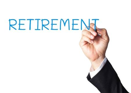 reverse: businessman hand writing retirement on white board Stock Photo