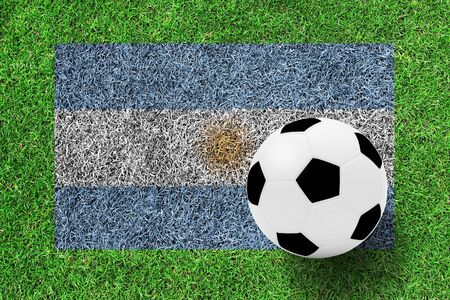 argentina flag: soccer ball on Flag of Argentina as a painting on green grass background Stock Photo