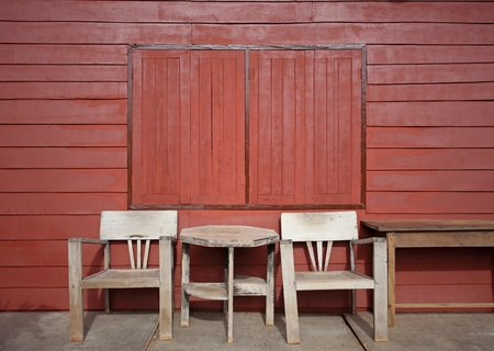 Old wooden chair against wooden wall Stock Photo - 21424177