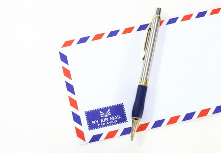 post scripts: air mail envelope with pen  Stock Photo