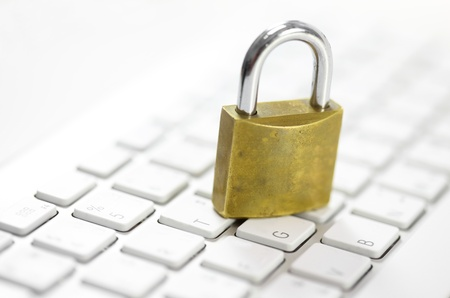 padlock on white keyboard network security conception photo