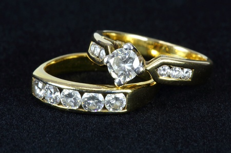 Two diamond ring on black background