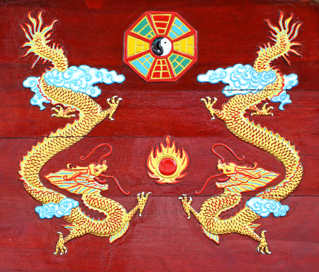 Golden Dragon carved  wood background Stock Photo - 22404077