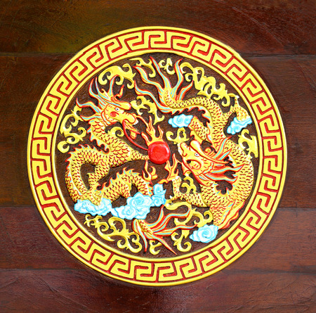 Golden Dragon carved  wood background photo