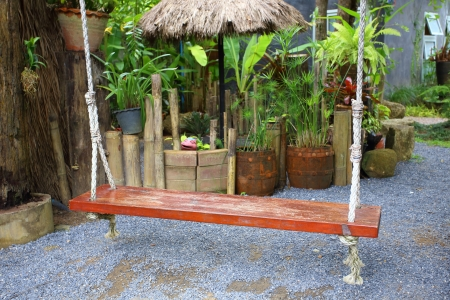Wood swing in the green garden  photo