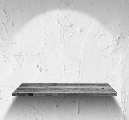 empty wooden shelf on white wall photo