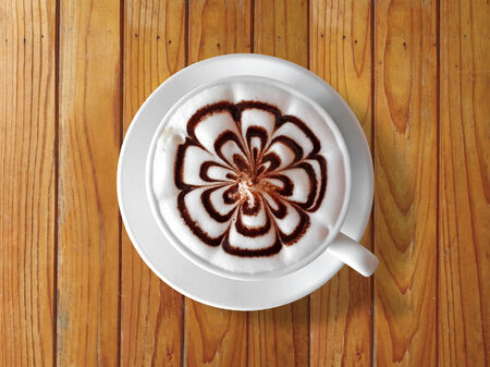cappaccino: cup of coffee latte on  wood table background