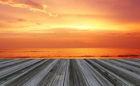 sun down: wood floor terrace perspective and sun set twilight seascape  Stock Photo