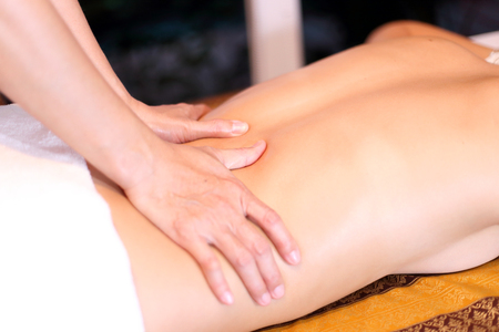 woman getting back massage at a spa Stock Photo - 23447298