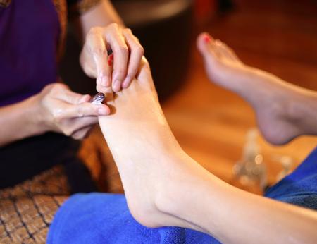 reflexology foot massage, spa foot treatment by wood stick,Thailand  Stock Photo - 23447302