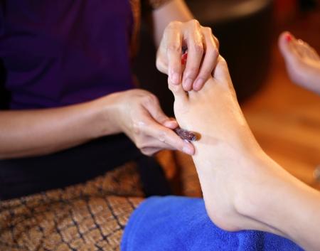 restore energy flow: reflexology foot massage, spa foot treatment by wood stick,Thailand