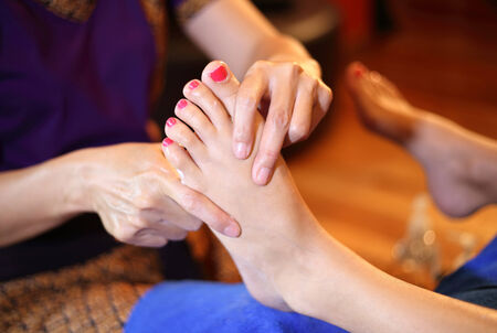 reflexology foot massage, spa foot treatment by wood stick,Thailand Stock Photo - 23447304