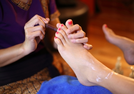 reflexology foot massage, spa foot treatment by wood stick,Thailand Stock Photo - 23447307