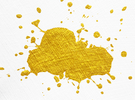 spatter: splash of golden pain on white background Stock Photo