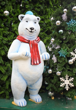 white teddy bear with decorations under the Christmas tree  photo