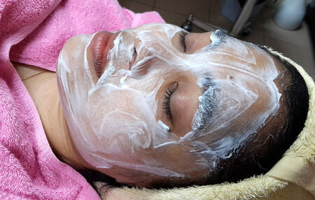 asian woman with facial mask at a beauty salon  photo