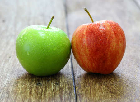 rosaceae: red and green apple fruit on wood background