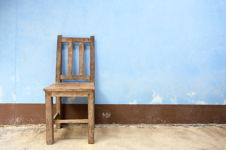 make dirty: Old Wooden Chair in Abandoned Building  Stock Photo