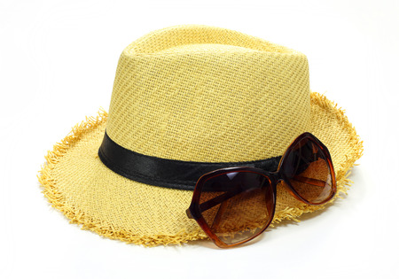 hat and sun glasses isolated on white  photo