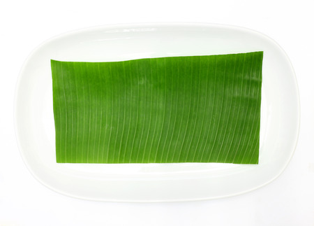 banana leaf on blank plate for edit food or subject on photo