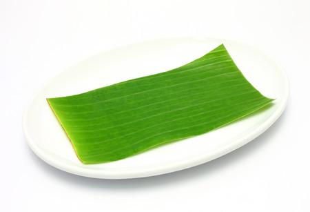 banana leaf: banana leaf on blank plate for edit food or subject on Stock Photo