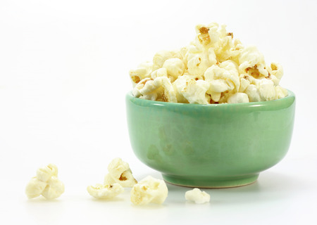 Bowl of popcorn on white background  photo