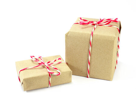 pack string: brown paper parcel tied with red and white string on white background