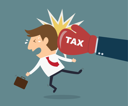 taxes: business man punch by tax hand concept