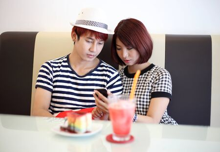 young couple taking selfie in coffee shop. photo