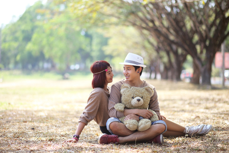 Attractive asian couple in love together in the park photo