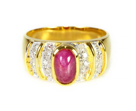 sumptuousness: gold ring with ruby and diamond on white background Stock Photo