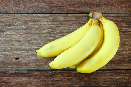 banana slice: Fresh bananas on wooden background