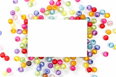 colorful beads: empty white paper on colorful beads on white background
