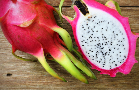 pitaya: Juicy pink pitaya on wooden table closeup