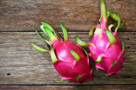 juicy: Juicy pink pitaya on wooden table closeup