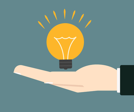 concepts and ideas: businessman hand holding lightbulb concept of idea