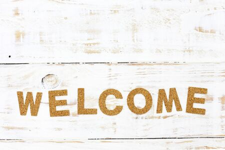 bulletins: the word welcome cork on white wood background Stock Photo
