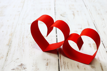 space wood: red paper heart copy space on white wood background