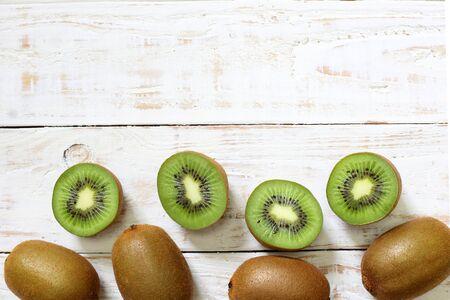 kiwi: Kiwi fruit on white wooden background Stock Photo