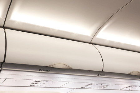 compartments: Overhead compartment in commercial aircraft.