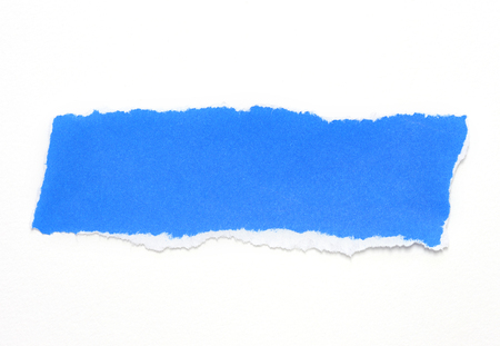 blue paper tears on white background