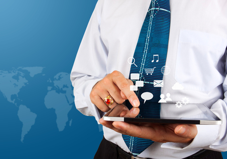 Business man use tablet pc with social media icons 写真素材
