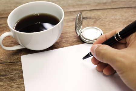 close up of male business hand signing document blank paper copy space