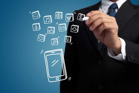 business man hand draw smartphone and social media icon
