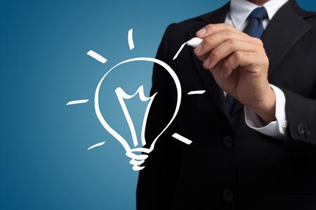 man hand-drawn light bulbs on a virtual interface