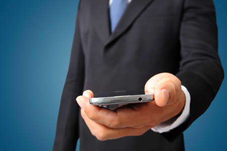 cell phones: Close up of a business man holding mobile smart phone