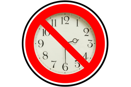 red sign: Clock with a red no entry sign overlay white background. Stop the time concept time deadline concept stress concept.