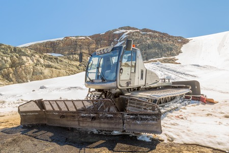 snowcat: A snow-cat, machine for snow removal, preparation ski trails. Stock Photo